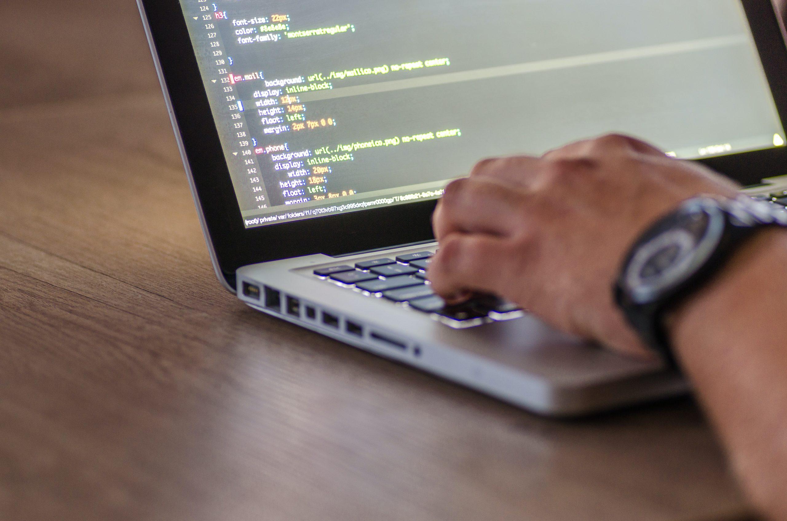 Programmer coding an app