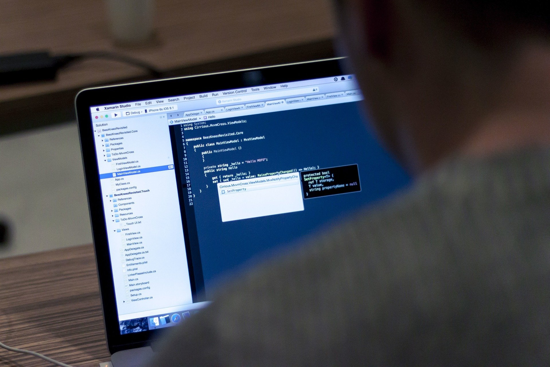 person testing code on computer